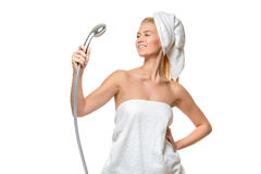 Woman in towel singing using shower head Royalty Free Stock Photo