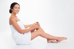 Woman in towel sitting on the floor Royalty Free Stock Images