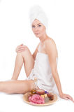 Woman with towel and spa products Royalty Free Stock Photos