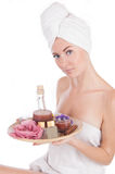 Woman with towel and spa products Stock Images