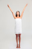 Woman in towel standing with raised hands up Stock Photos