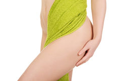 Woman with towel touching thigh. Stock Photos