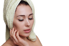 Woman in towel turban on white background. Skin care. Young beautiful woman in towel turban on white background. Skin care. Spa salon. Beauty and health. Clear Royalty Free Stock Photography