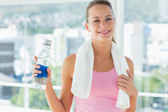 Woman with towel and water bottle in gym Royalty Free Stock Photo
