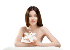 Woman in towel with white orchard Stock Image