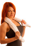 Woman with towel after work out in fitness isolated over white b Stock Photo