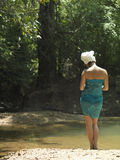 Woman With Towel Wrapped on Head And Body By Lake Royalty Free Stock Images