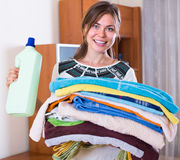 Woman with towels after laundry Stock Photos