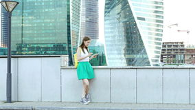 Woman in town using electronic tablet stock video