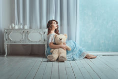 Woman with a toy bear. Stock Image