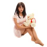 Woman and a toy bear Stock Images