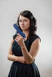 Woman with toy gun Stock Photos