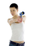 Woman with toy gun. Half body portrait of attractive woman with tank top aiming toy gun; white studio background Stock Photography