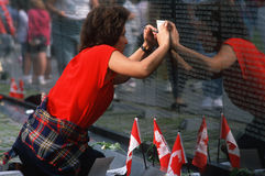 Woman tracing name at Vietnam Wall Stock Photography