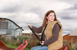 Woman on a tractor Royalty Free Stock Photography
