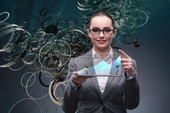 The woman trader with tablet and chart Stock Images