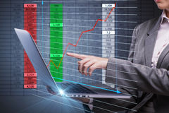 The woman trader working on laptop in stock trading concept Stock Image