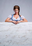 Woman in traditional bavarian clothes, Oktoberfest. Studio shot. Royalty Free Stock Photography