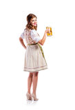 Woman in traditional bavarian dress holding beer Royalty Free Stock Photography