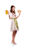 Woman in traditional bavarian dress holding beer and pretzel Royalty Free Stock Images
