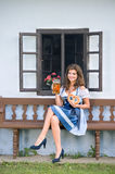 Woman in traditional bavarian dress holding beer and pretzel Royalty Free Stock Photos