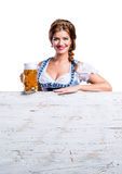 Woman in traditional bavarian dress holding mug of beer Royalty Free Stock Photos