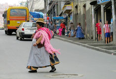 Woman in traditional bolivian hat on the street Stock Images