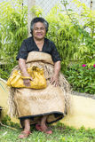 Woman in traditional Clothes of Tonga Stock Photo