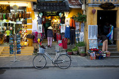 Woman in traditional conical hat on the market street of Hoi An Royalty Free Stock Image