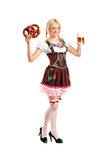 Woman in a traditional costume holding a beer Royalty Free Stock Photography
