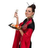 Woman in traditional dress with eastern food Stock Images