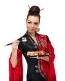 Woman in traditional dress with eastern food Royalty Free Stock Images