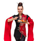 Woman in traditional dress with eastern food Royalty Free Stock Photography