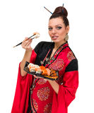 Woman in traditional dress with eastern food Royalty Free Stock Image