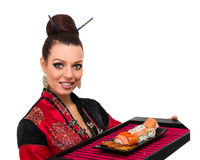 Woman in traditional dress with eastern food Stock Photos