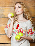 Woman in traditional dress holding apples in her hands Royalty Free Stock Images