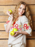 Woman in traditional dress holding apples in her hands Royalty Free Stock Photography