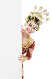 Woman with traditional dress of java with blank board. Woman wearing traditional dress of java. hiding behind blank white board Royalty Free Stock Photos
