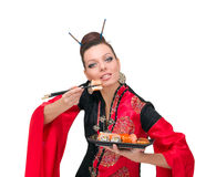 Woman in traditional dress with sushi Royalty Free Stock Image