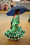 Woman in traditional dress under the rain,  Fair in Seville, Andalusia, Spain Royalty Free Stock Photos
