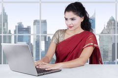 Woman with traditional indian clothes working in office Royalty Free Stock Photos