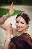 Woman in traditional indian clothing with oriental makeup and jewelry Stock Photography