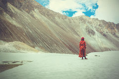 Woman in traditional Indian dress standing in desert in Ladakh, India Stock Images