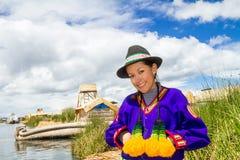 Woman in traditional indigenous clothing, Peru. Hispanic woman in traditional indigenous clothing, Puno, Uros islands, Peru Stock Photo