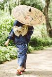 Woman in traditional Japanese dress Stock Photography