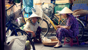 Local market in Hoi An. Woman in a traditional local market in Hoi An in Vietnam royalty free stock images