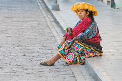 Woman in traditional peruvian clothes Arequipa Peru. Arequipa Peru August 20, 2018 a lady in traditional clothes waits for the bus along a street in the historic stock photos