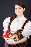 Woman in traditional Polish clothes basket of eggs stock image