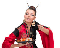 Woman in traditional red dress with eastern food Royalty Free Stock Photography