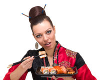 Woman in traditional red dress with eastern food Stock Image